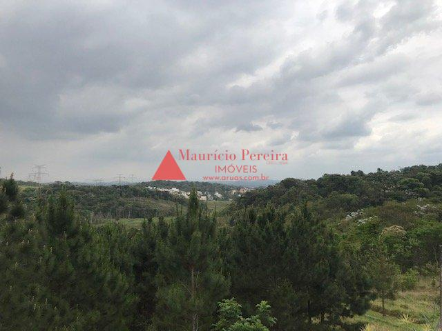Casa com Varanda com vista para área verde